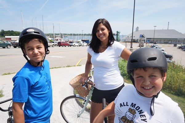 Photo of Emily and her boys on bikes